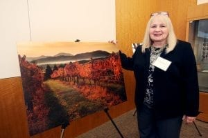 "Deb Snelson with her photograph ""Autumn on the Vine,"" our 2016 Best in Show Winner."