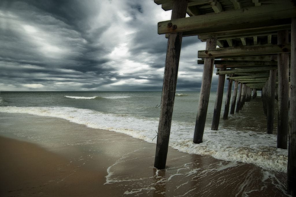 Under the Pier by Rick Kidd (Sandbridge Pier in Virginia Beach)